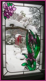 Kiosk and Snow Scene through frame