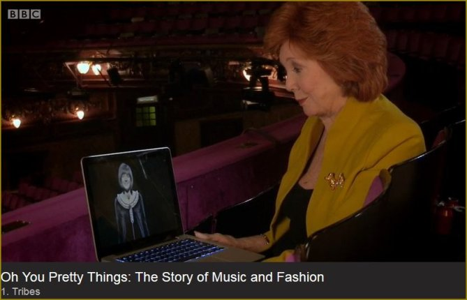 Cilla with lap top image of earlier self