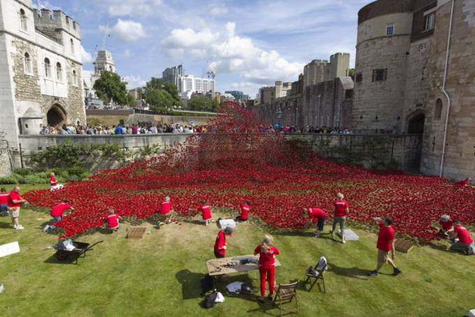 Workers carefully placing the poppies in the Tower Moat