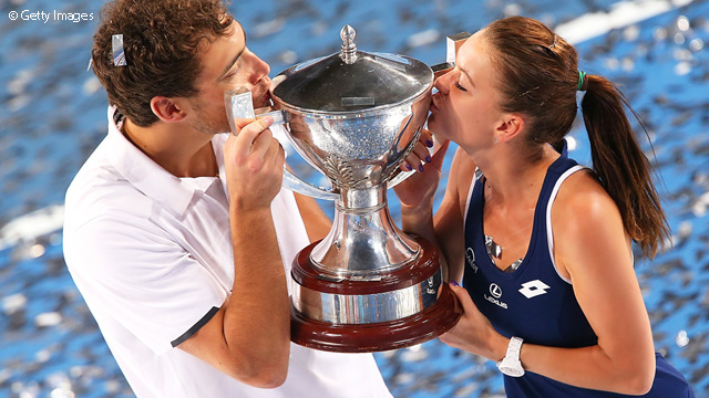 Aga and Jerzy kiss the Trophy