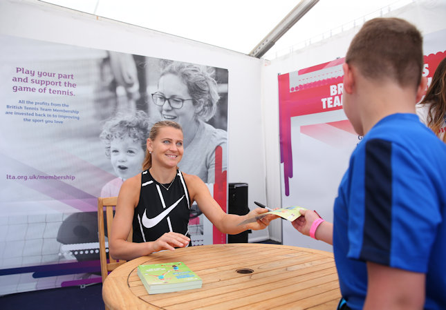 Lucy Safarova signing autographs at the Nottingham Open