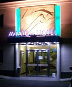 Entrance to Aviator Hotel accommodation at night