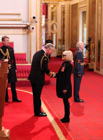 Bh receiving OBE from Charles