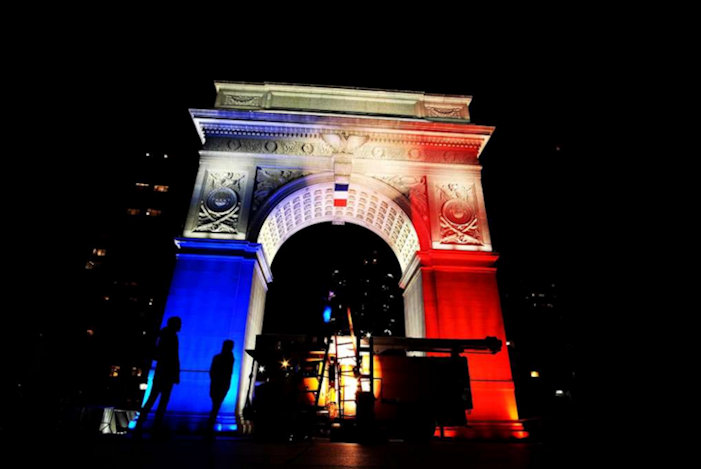 The Washington Square Park arch lit with the French national colours in New York