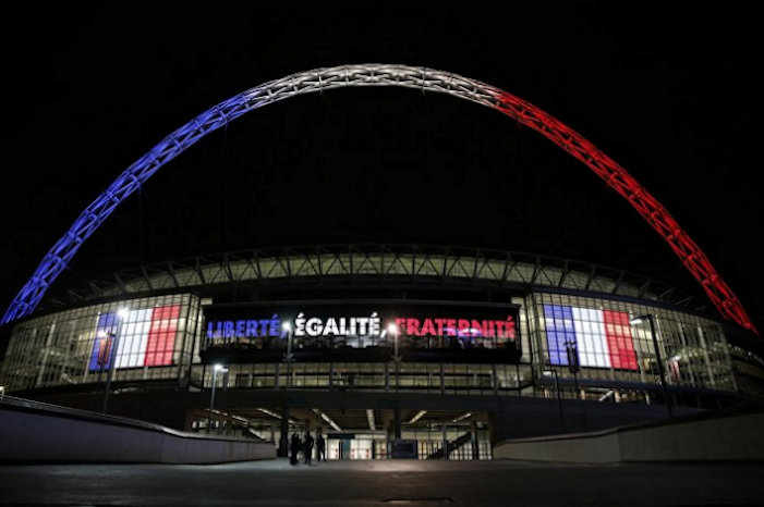 Wembley Stadium lit up in tricolour