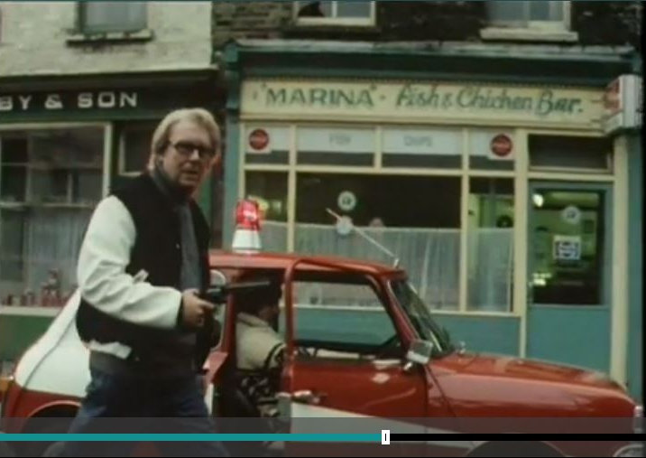 Eric Morecambe walking the Mini