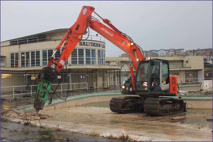 Digger in place to rip out the old swimming area