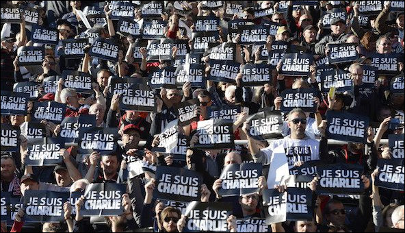 Crowd holding Je Suis Charlie posters