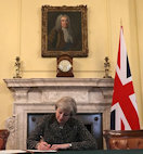 Prime Minister Theresa May signing Brexit letter