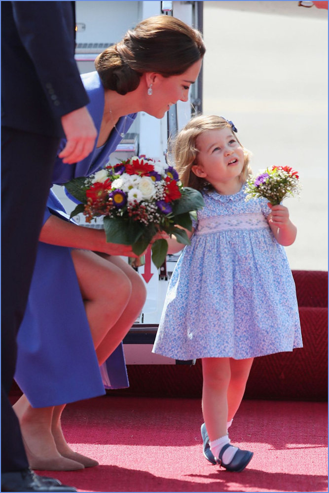 Duchess of Cambridge and Charlotte in Poland