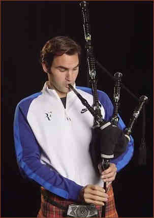 McFederer attempting the bagpipes in Glasgow 2017