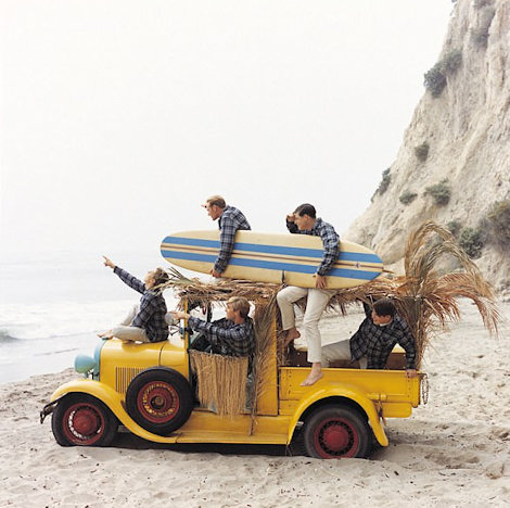 The Original Beach Boys including Dennis on the beach with surfboards