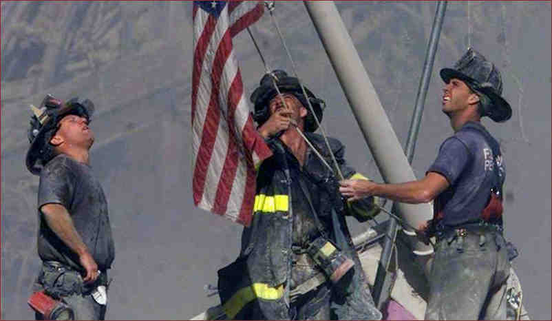 Firemen raising the flag at the site of 9/11