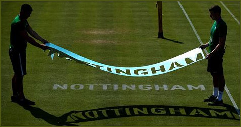 Stencilling Nottingham onto a tennis court