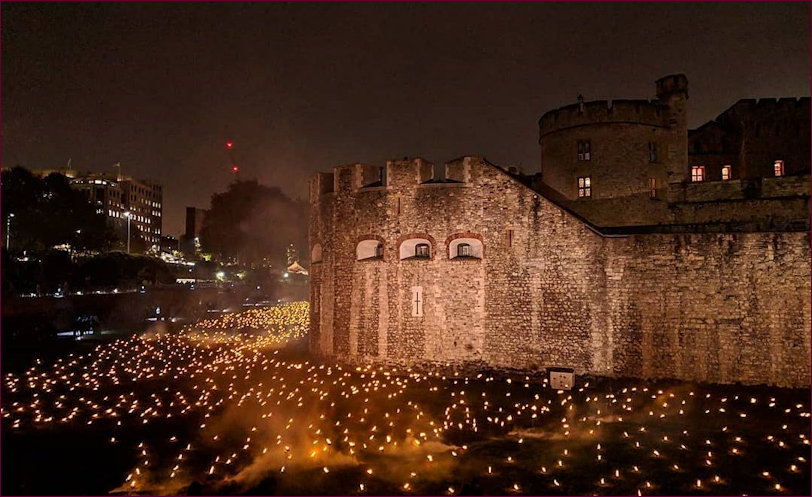The Tower illuminated and lit up with the torches in the moat