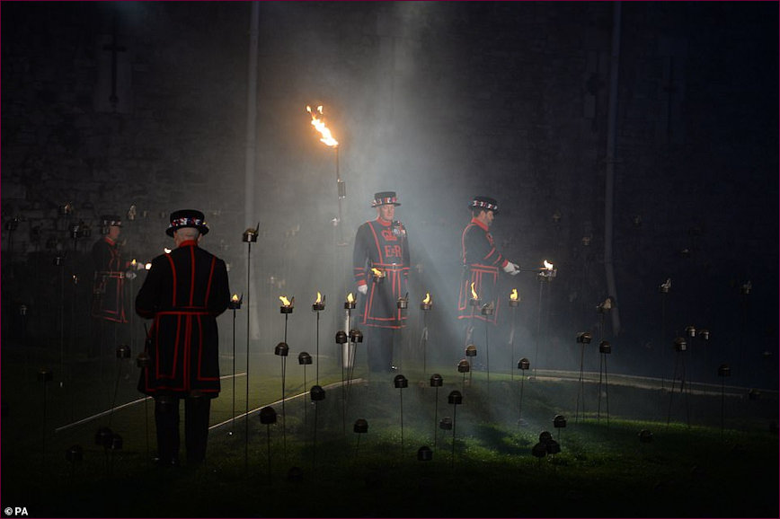 Three Beafeaters in position to hold vigil in the moat during lighting ceremony