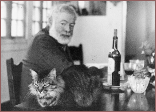 Hemingway with cat and bottle