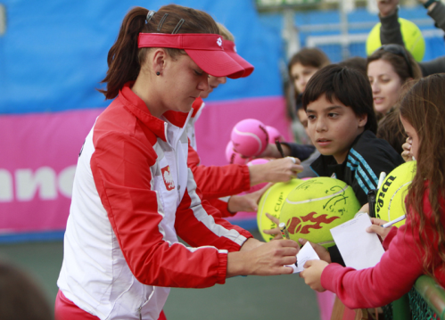 Aga signing autographs