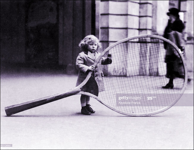 A Giant Tennis Racket for a very small girl