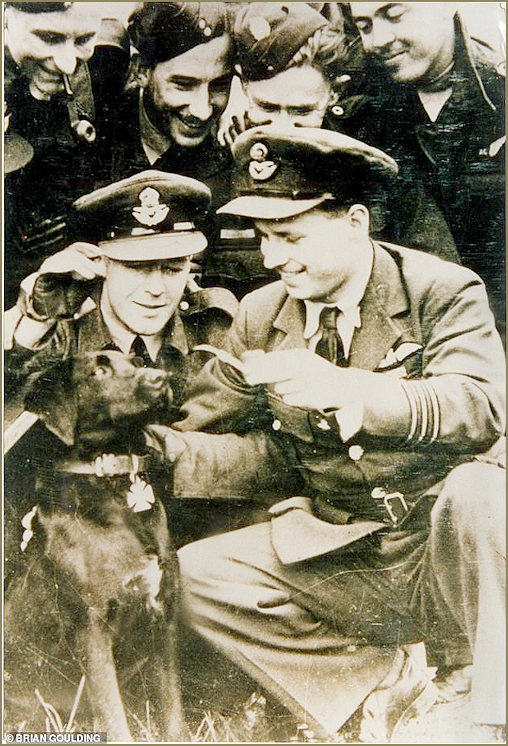 Wing Commander Guy Gibson VC (right), Dambusters hero with his devoted dog 'N****r'. The black labrador was kiiled by a hit-and-run driver just hours before Gibson led the RAF's crack 617 squadron to drop 'bouncing bombs' on German dams in May 1943