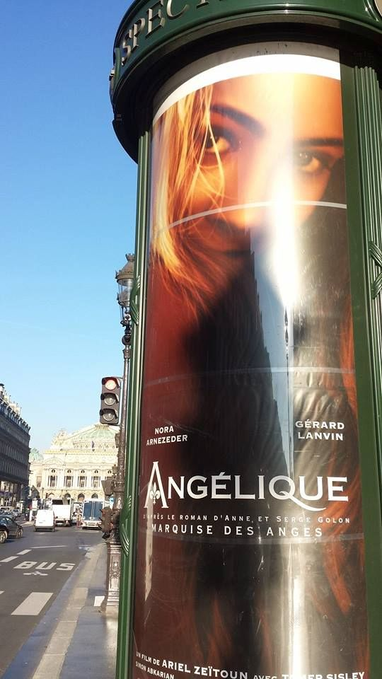 Film Poster in advertising tower near the Opera in Paris
